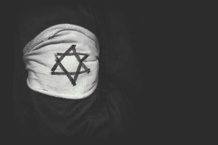 Foto de shoulder patch Jewish star of David in concentration camps in Germany. The concept of the genocide of the Jews. The day of memory of victims of the Holocaust. black and white retro photo - Imagen libre de derechos