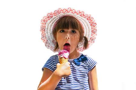 Foto de little sweetheart girl in hat eats ice cream on an isolated white background - Imagen libre de derechos