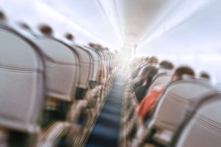Photo for aerophobias concept. plane shakes during turbulence flying air hole. Blur image commercial plane moving fast downwards. Fear of flying. collapse slump, depression, downfall, debacle, subsidence, trip. - Royalty Free Image