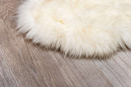 Photo for Decorative fur carpet on wood floor background - Royalty Free Image
