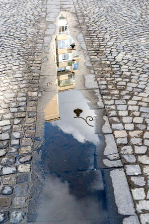 puddle with reflections - selective focus, copy space