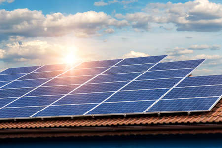 Photo pour Solar panel on a red roof  - image libre de droit