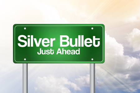 Foto de Silver Bullet Just Ahead Green Road Sign business concept - Imagen libre de derechos