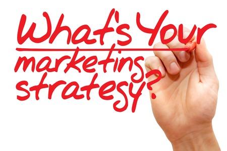 Foto de Hand writing What's Your Marketing Strategy with red marker, business concept - Imagen libre de derechos