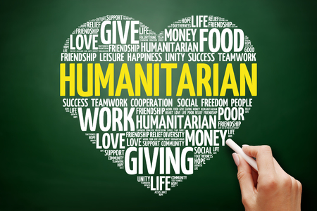 Foto de Humanitarian heart word cloud collage, concept on blackboard - Imagen libre de derechos