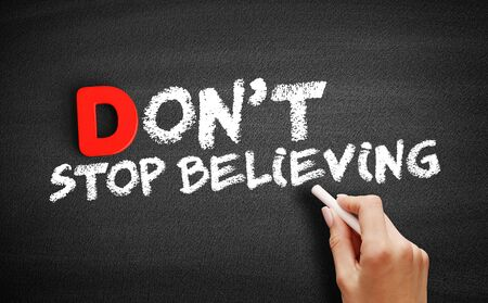 Photo pour Don't Stop Believing text on blackboard, business concept background - image libre de droit