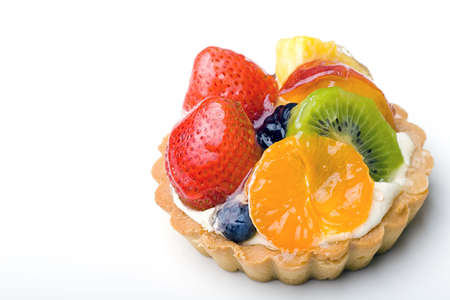 Strawberry, kiwi, tangerine, pineapple delicious dessert fruit tart pastry with whipped cream layer