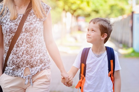 Photo for Little 7 years old boy going to school with his mother - Royalty Free Image