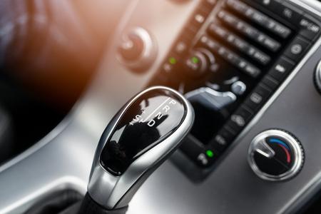 Foto de Close-up on automatic transmission lever in modern car - Imagen libre de derechos