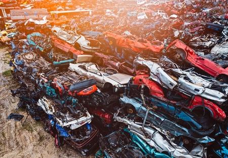 Foto de Destroyed scrapped cars stacked on a scrap yard. Car recycling - Imagen libre de derechos