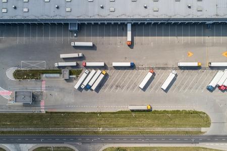 Foto de Aerial drone view on warehouse and logistic center. Logistic and transport concept - Imagen libre de derechos