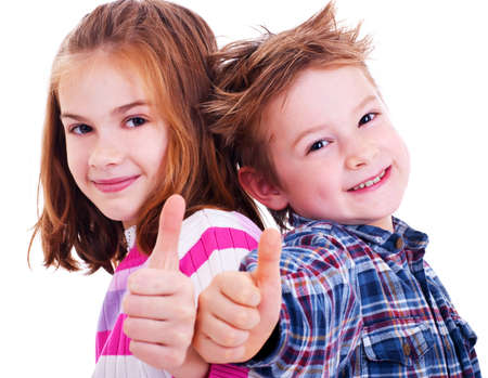 Photo for Happy boy and girl  thumbs up - Royalty Free Image