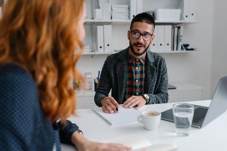 Photo pour Recruiter interviewing job candidate - image libre de droit