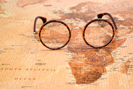 Photo for Glasses on a map of a world - Africa - Royalty Free Image
