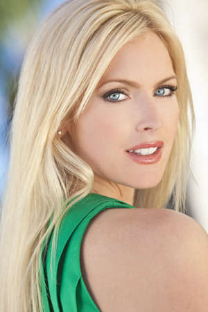 Outdoor portrait of a beautiful young blond woman in her thirties