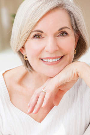 Photo for Portrait of an attractive elegant senior woman relaxing at home. - Royalty Free Image