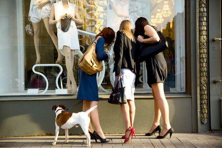three women at the shop window