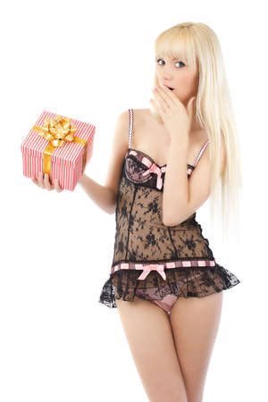 Beautiful young girl in sexy pink lingerie with gift box on white background