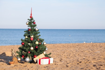 Foto de Christmas on the beach with gifts new year - Imagen libre de derechos