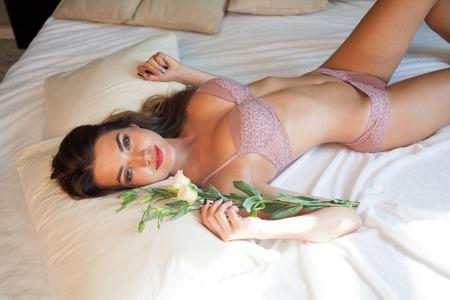 Foto de beautiful woman underwear lies on the bed - Imagen libre de derechos