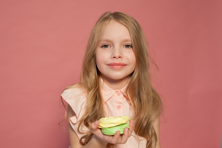Photo for small girl in hand holds a sweet cupcake cake candy - Royalty Free Image