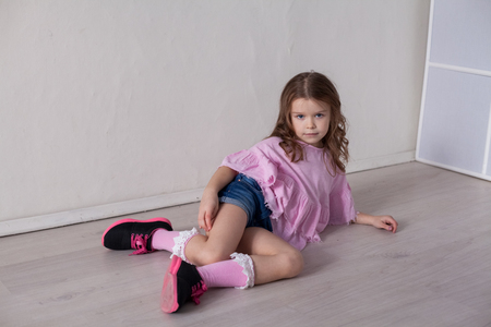 Photo pour Portrait of a beautiful little girl in a pink dress five years - image libre de droit