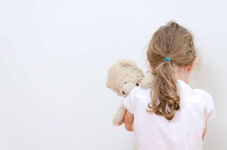 Foto de Little girl crying in the corner  Domestic violence concept  - Imagen libre de derechos