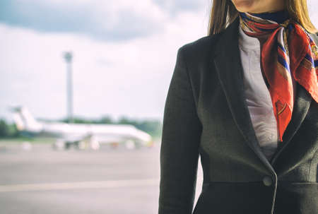 Foto de Stewardess on the airfield  Place for your text  - Imagen libre de derechos