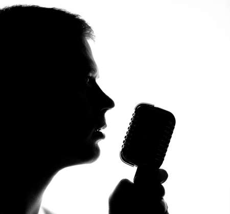 Photo for Silhouette of a man with microphone. - Royalty Free Image
