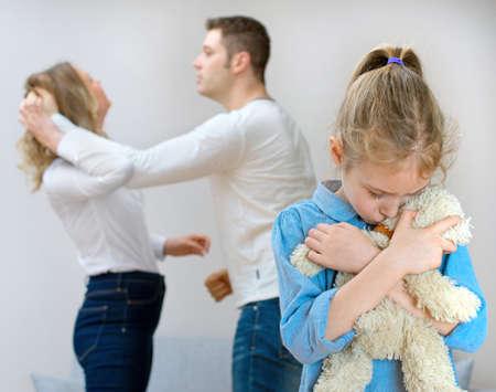 Foto de Parents quarreling at home, child is suffering. - Imagen libre de derechos
