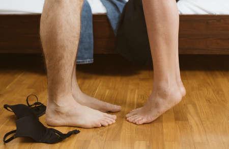 Foto de Woman and man making love in bedroom. - Imagen libre de derechos
