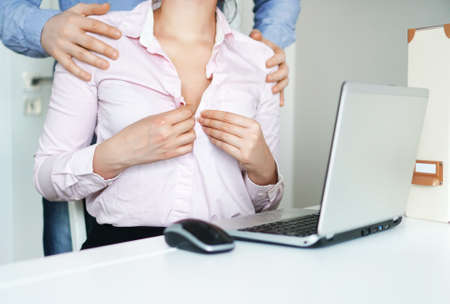 Photo for Sexual flirt at work. Secretary's unbuttons her blouse. - Royalty Free Image