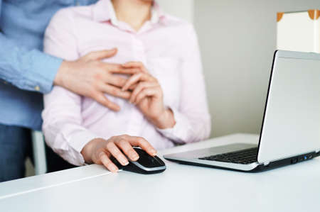 Photo for Flirt at work. Man touching secretary's breasts. - Royalty Free Image