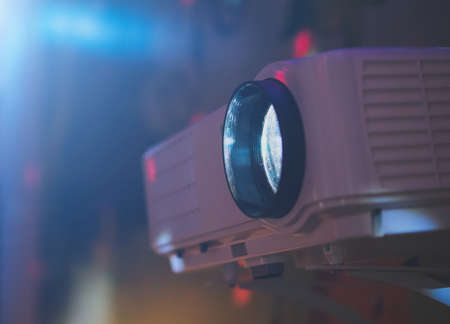 Foto per Movie projector in action mounted on the wall. - Immagine Royalty Free