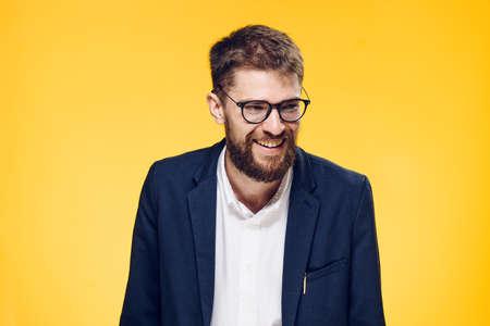 Foto de Businessman smiling, businessman in glasses, businessman on yellow background. - Imagen libre de derechos
