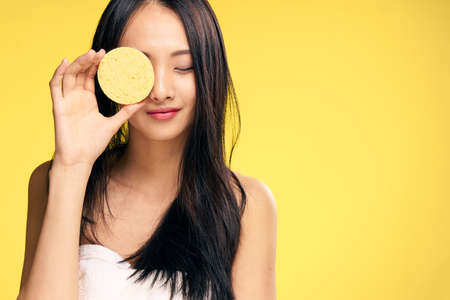 Photo pour Skin care, woman with sponge, sponge, woman on yellow background portrait. - image libre de droit