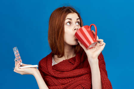 a woman in a plaid drinks tea.