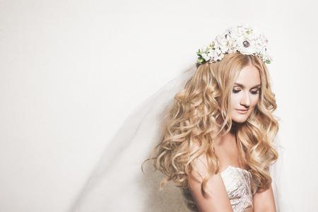 Foto de Portrait of affectionate blond bride. Wedding makeup and hairdo. Wedding decoration - Imagen libre de derechos