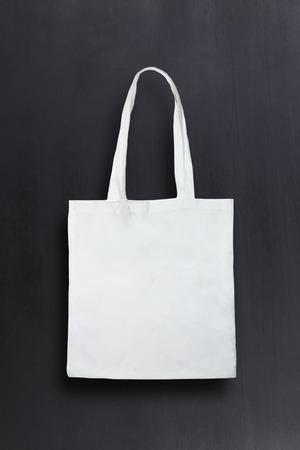 Foto de White fabric bag against chalkboard background - Imagen libre de derechos