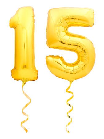 Foto de Golden number 15 fifteen made of inflatable balloon with golden ribbon isolated on white background - Imagen libre de derechos