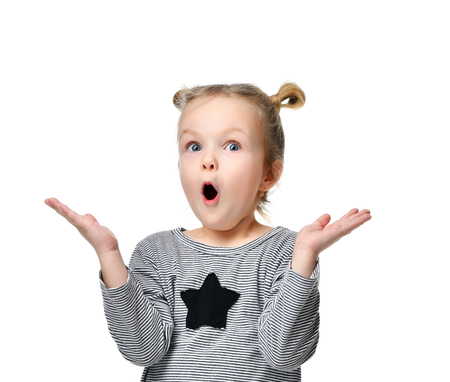 Photo pour Young girl kid surprised and shocked with open mouth looking up hands spread isolated on a white background - image libre de droit