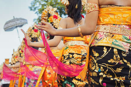 Photo for Group of beautiful Balinese girls in bright traditional costumes - sarongs decorated by hindu Barong and Garuda masks. Arts and culture of Bali island and Indonesia people and asian travel backgrounds - Royalty Free Image