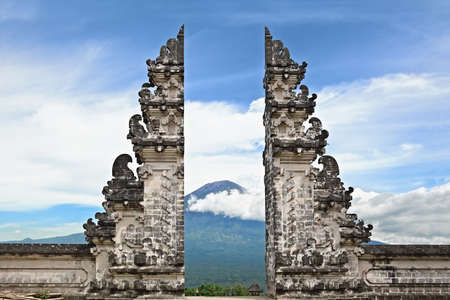 Photo for Entrance gate Pintu Bintar to traditional temple Lempuyang on Agung mount background - Bali island symbol. Culture and architecture of Asian people, Indonesian and Balinese landscapes and wallpapers - Royalty Free Image