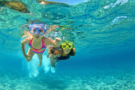 Photo for Happy family - mother with baby girl dive underwater with fun in sea pool. Healthy lifestyle, active parent, people water sport outdoor adventure, swimming lessons on beach summer holidays with child - Royalty Free Image