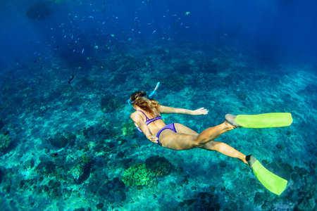 Photo for Happy family - girl in snorkeling mask dive underwater with tropical fishes in coral reef sea pool. Travel lifestyle, water sport outdoor adventure, swimming lessons on summer beach holiday with kids - Royalty Free Image