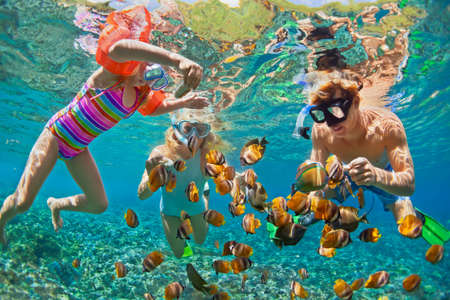 Photo for Happy family - father, mother, child in snorkeling mask dive underwater with tropical fishes in coral reef sea pool. Travel lifestyle, water sport adventure, swimming on summer beach holiday with kids - Royalty Free Image
