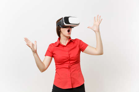 Foto de Portrait of young smart business woman in red shirt, black skirt in headset of virtual reality on head isolated on white background. Education or teaching of future in high school university concept - Imagen libre de derechos