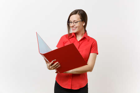 Foto de Portrait of young successful business teacher woman in red shirt, glasses holding folder with paper work documents isolated on white background. Education teaching in high school university concept - Imagen libre de derechos