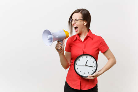 Photo pour Portrait of young business teacher woman in red shirt holding round clock, scream in megaphone, announces discounts sale, isolated on white background. Hot news, communication concept.. Hurry up - image libre de droit
