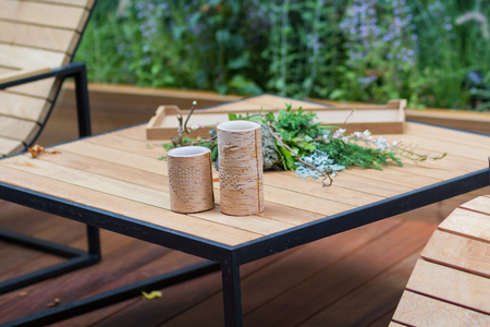 Photo pour Natural wooden armchairs on patio for relaxation. Interior - image libre de droit